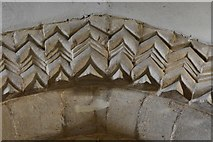 SP9599 : Wakerley: St. John the Baptist church: Zig zag Norman carving on the chancel arch 2 by Michael Garlick