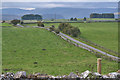 NY5717 : Road and fields east of Stonygill Bridge by Nigel Brown
