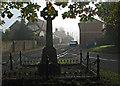 TL3256 : Bourn: war memorial and High Street by John Sutton