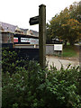 TM2446 : Footpath sign off Main Road by Geographer