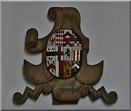 TM1273 : Yaxley; St. Mary the Virgin Church: Tudor wooden armorial mounted on south aisle wall 3 by Michael Garlick