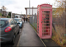 NT4935 : A red telephone box in Galashiels by Walter Baxter