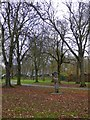 TQ2483 : Wooden sculpture in Queen's Park by David Smith