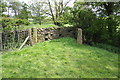 SD9650 : Gateposts at blocked gateway to field beside Denindale Beck by Roger Templeman