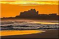 NU1835 : Bamburgh Castle at dawn by Ian Capper