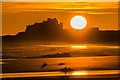 NU1835 : Bamburgh Castle at sunrise by Ian Capper
