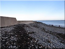 J3829 : Storm beach on the seaward side of southern wall of Newcastle Harbour by Eric Jones