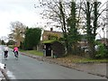 SK2310 : Cyclists passing Haunton's bus shelter by Christine Johnstone