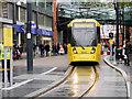SJ8398 : Metrolink Tram on Corporation Street by David Dixon
