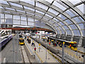 SJ8499 : Metrolink Platforms at Victoria Station by David Dixon