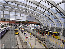 SJ8499 : Metrolink Platforms at Victoria Station by David Dixon