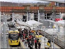 SJ8499 : Passengers Disembarking at Metrolink Platform D, Manchester Victoria Station by David Dixon