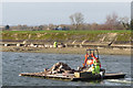 SP9114 : Repairing Startops Reservoir (13) Transporting the Rocks by Raft by Chris Reynolds