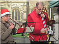 SP9211 : Trombones play at the Xmas Farmers Market, Tring by Chris Reynolds