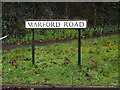 TL1813 : Marford Road sign by Adrian Cable