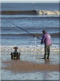 NZ3573 : Sea angler on Whitley Sands by Oliver Dixon