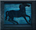 TQ3589 : Black horse sculpture with mosaic background, Blackhorse Road Station by Julian Osley