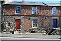 NU1033 : Houses in Belford by Philip Halling