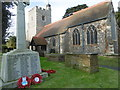 TQ0878 : The war memorial and the Church of St Peter and St Paul, Harlington by Marathon