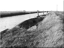 TM4599 : Damaged revetments in the New Cut by Evelyn Simak