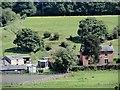 NZ1256 : Armondside farm from across the river by Robert Graham