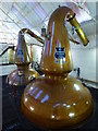 NT4466 : Wash and Low Wines Stills at Glenkinchie Distillery by Brian Turner
