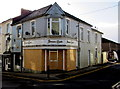 SO1911 : Boarded up shop on a town centre corner, Brynmawr by Jaggery