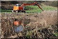 SO8503 : Excavator beside the Thames and Severn Canal by Philip Halling