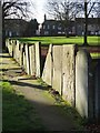 SK5978 : Wall of old gravestones - Worksop Priory by Neil Theasby