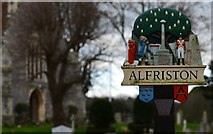 TQ5203 : Alfriston: The Village Sign with St. Andrew's Church in the background by Michael Garlick