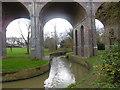 TQ2992 : Pymme's Brook in Arnos Park under the Piccadilly line by Marathon