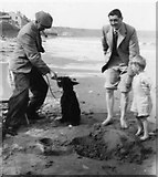 TA1280 : On the beach - how we were! by Unknown, but my father and I are the main subjects and the photo was with his papers