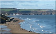 NZ8911 : Sunday strollers on the beach by Gordon Hatton