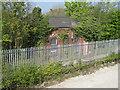 SJ3478 : Unidentified building next to Hooton railway station by John S Turner