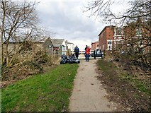 SJ9594 : Clearing up rubbish from Swains Valley by Gerald England