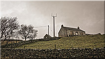 NY8233 : Abandoned cottage at Hilltop and mast by Peter Moore