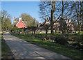 TL4349 : Newton: Town Street and Newton Hall by John Sutton