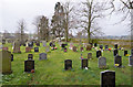 NY6624 : Graves at Church of St Margaret and St James by Trevor Littlewood