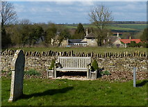 SP9599 : Seat in the churchyard of St John the Baptist by Mat Fascione