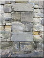 SJ3385 : Bench mark on wall buttress in Highfield South by John S Turner