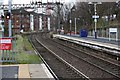 NS4871 : A west view along the platforms at Dalmuir railway station by Garry Cornes
