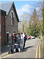 SP9211 : Good Friday in Tring (6) Passing the Vestry Hall by Chris Reynolds
