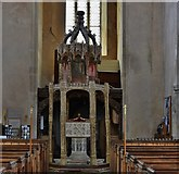 TG2834 : Trunch: St. Botolph's Church: The font (ca. 1350) and oak canopy (ca. 1500) by Michael Garlick