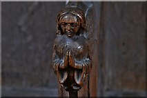 TG2834 : Trunch: St. Botolph's Church: Carving in the choir stalls 2 by Michael Garlick