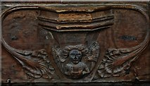 TG2834 : Trunch: St. Botolph's Church: C14th grotesque misericord 4 by Michael Garlick