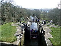"SE1039 : Narrowboat ""Marley's Drum"" locking down Bingley 5 Rise by Graham Hogg"