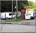 SO5916 : Red phonebox between two white vans, Lower Lydbrook by Jaggery