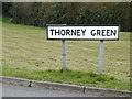 TM0660 : Thorney Green sign by Adrian Cable