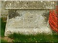 SK9401 : Bench mark, St Mary's Church, South Luffenham by Alan Murray-Rust