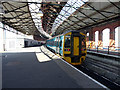 SH2482 : An Arriva Wales train stands in Holyhead station by John Lucas